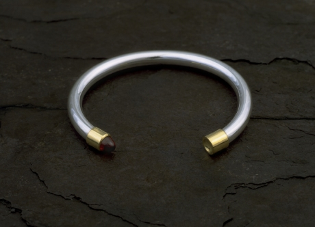 Silver Bangle with Gold Finials & Bullet Garnet by Steven Bourke, 2002